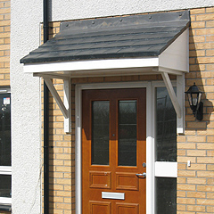 a variable width monopitch canopy up to 6600mm long timber grain effect sides and fascia tile or slate effect roof available with or without brackets